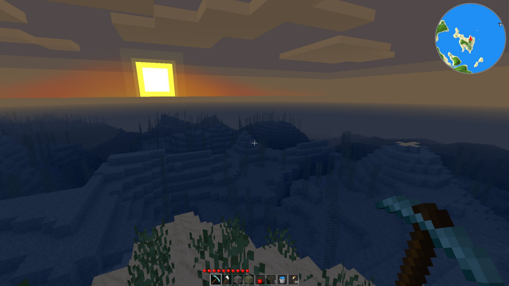Screenshot of Minetest showing sun rising over a sea and landscape